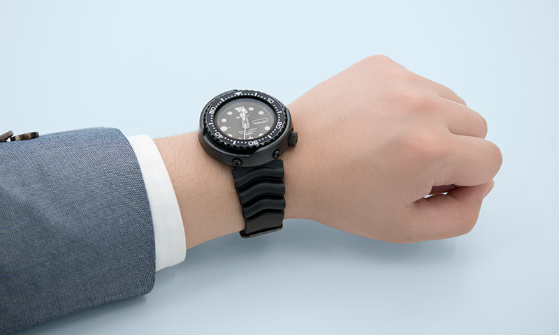 Photo of a wrist wearing the Tuna Can watch