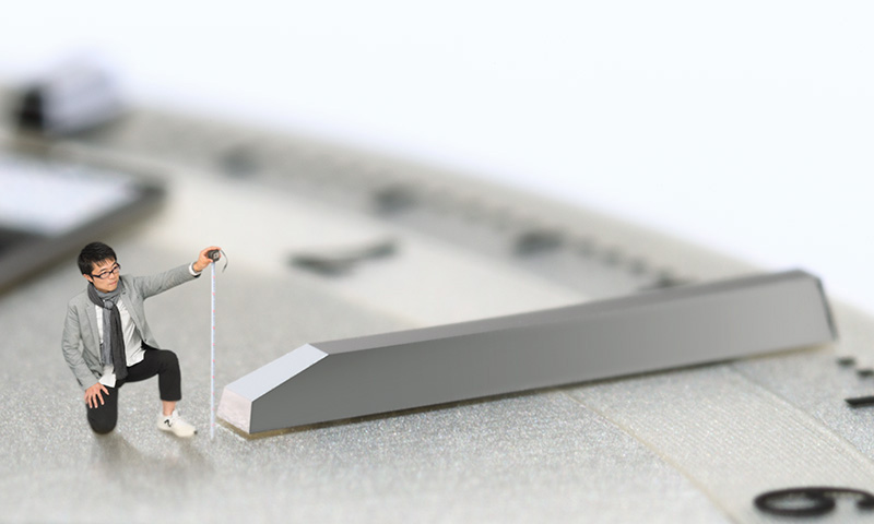 Image of 1/100th size Kubo taking measurements on the dial
